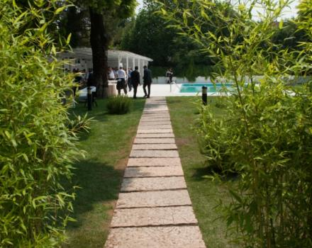 "Entrance to the garden with a swimming pool ""Barefoot in the Garden."" The summer space at the Best Western Hotel Cristallo."
